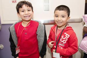Two students smile and proudly wear red on Brandon Conde Day