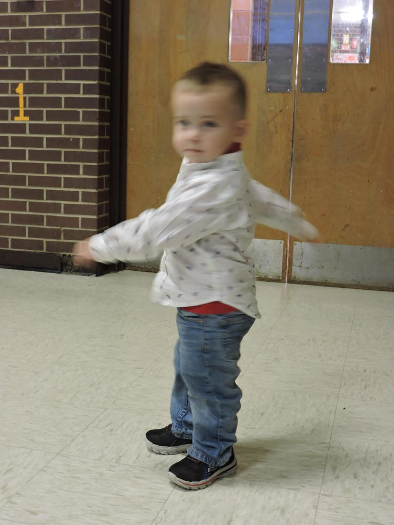 Toddler twirling at Veteran's program