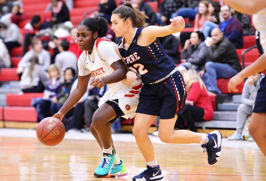An EHS player is closely guarded as she dribbles into the lane