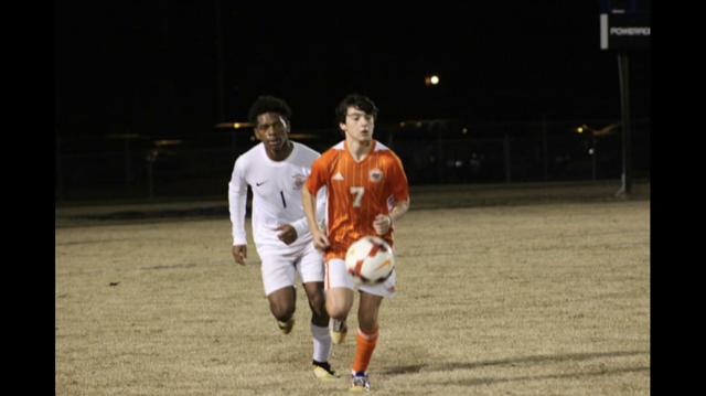 Trey W. kicking the soccer ball.
