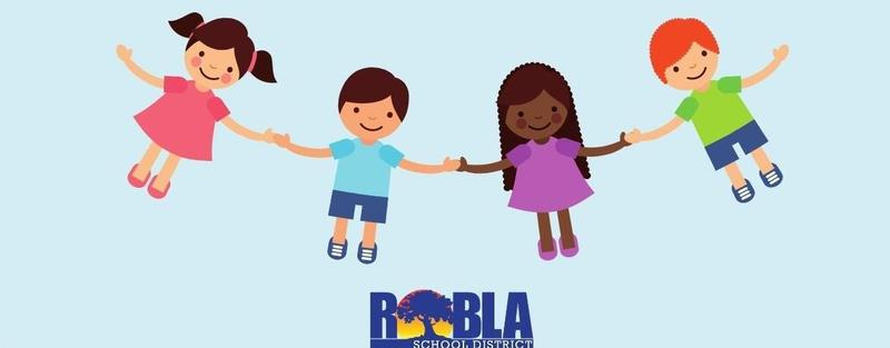 Four smiling children holding hands
