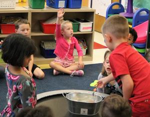 Kindergartners in Mrs. Surace's class listened to