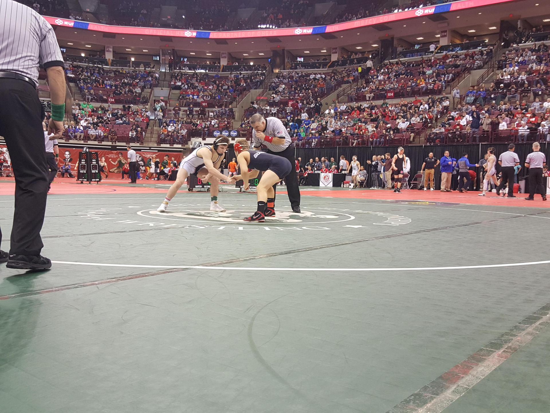 Zach taking the Mat at State