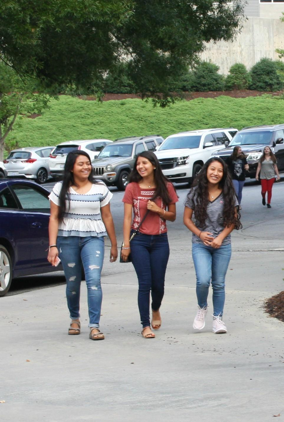 Three girls arrive at school on the first day at Wilkes Early College High School