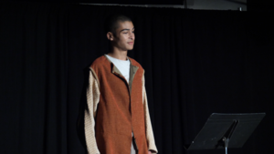 Chris P. performing a monologue