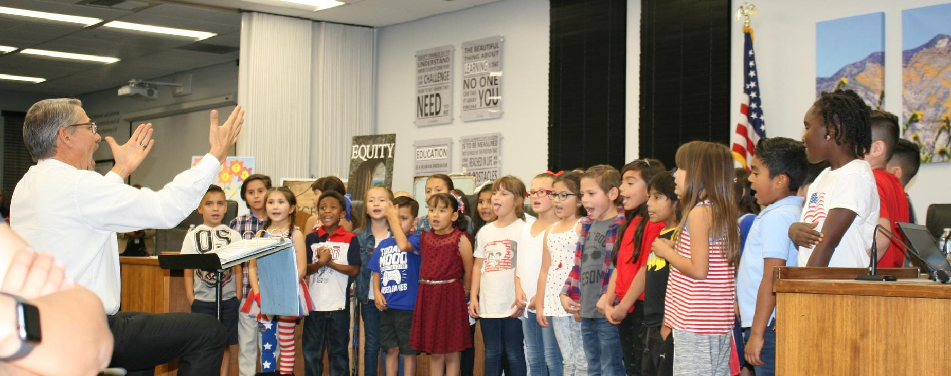 Mr. Stubin directed the De Anza Elementary Choir in a wonderful musical tribute to Veterans to open the November Board of Trustees meeting.