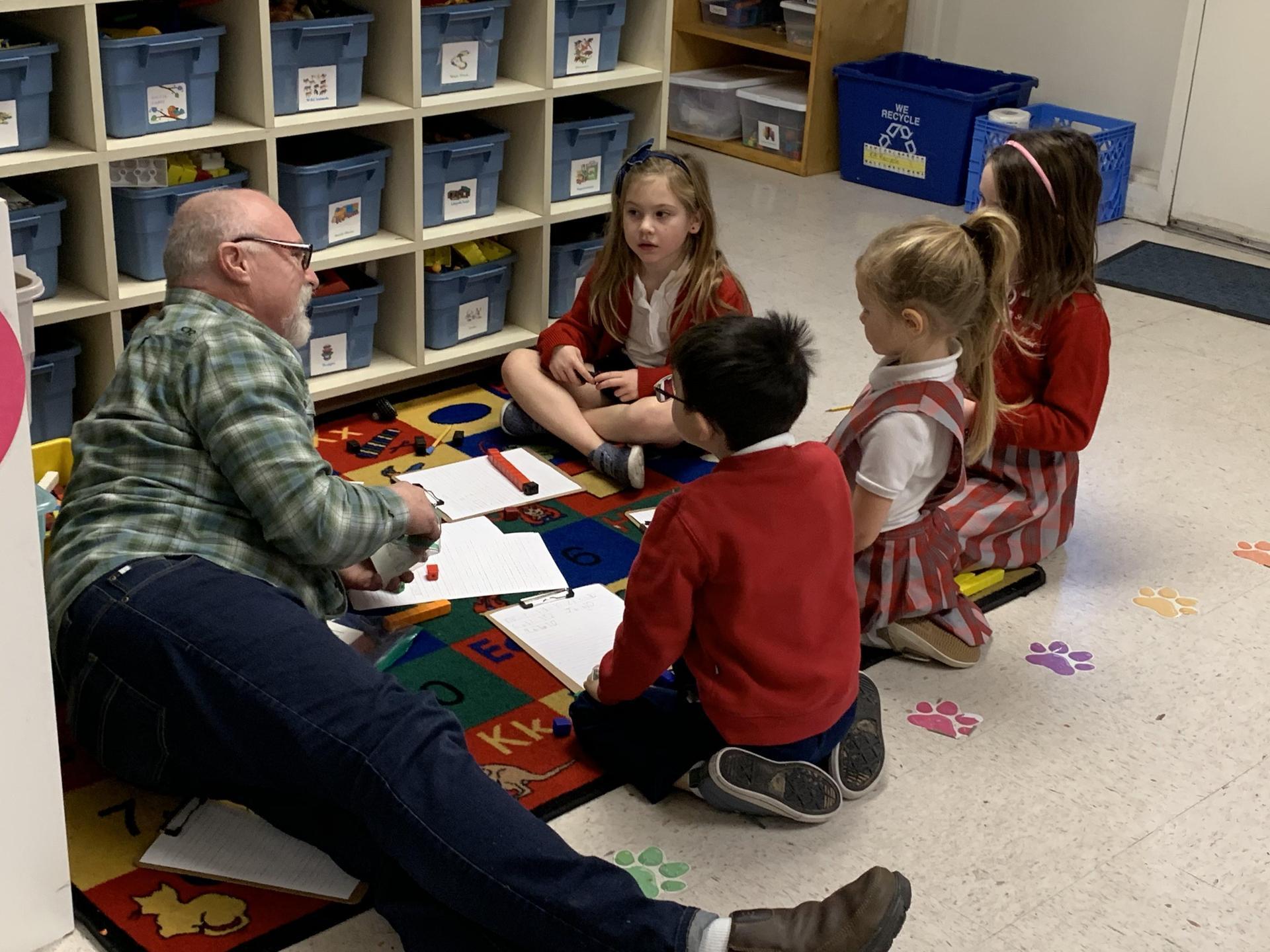 Parent volunteer with students