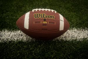 Image of a football on a field.