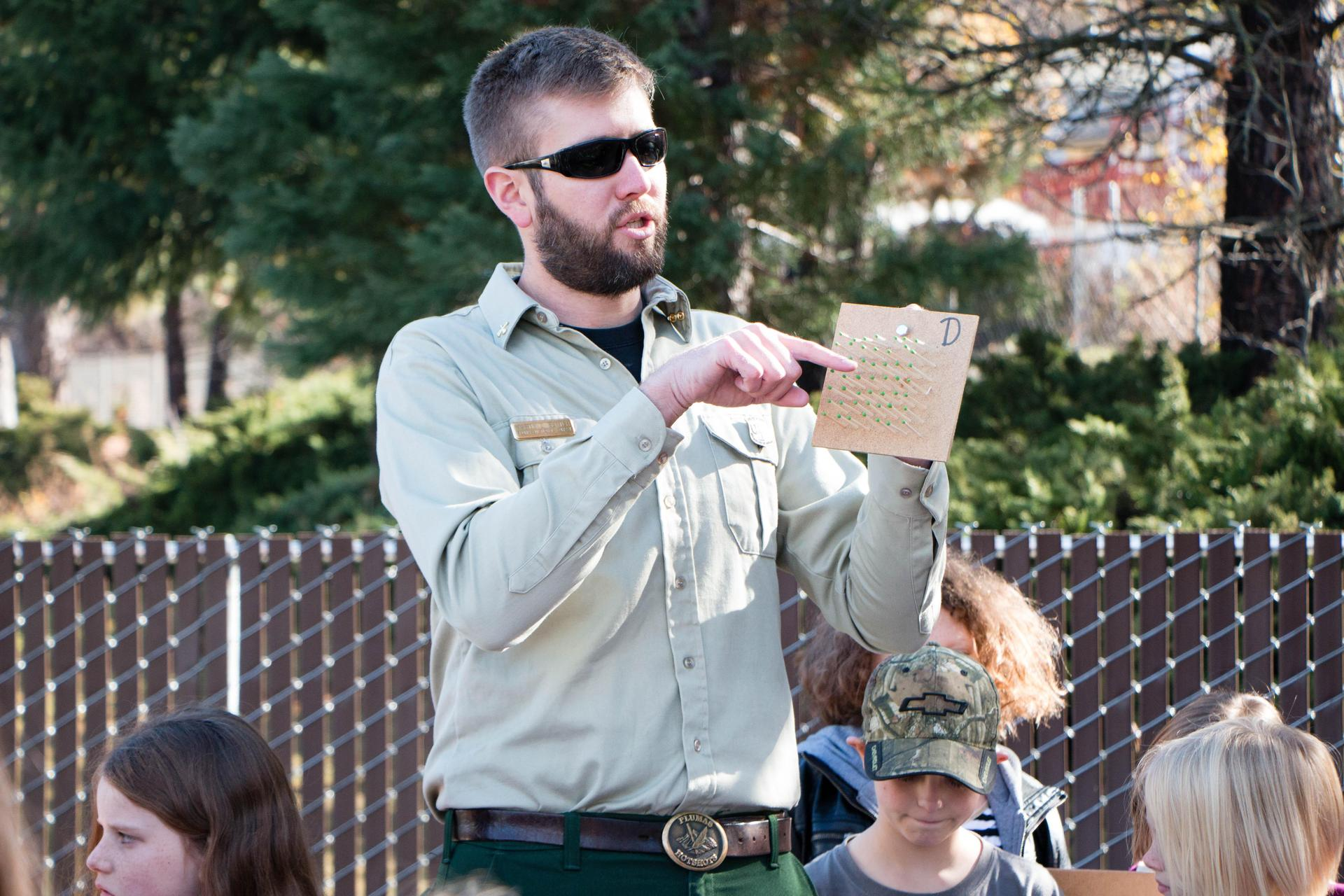 Plumas National Forest Service Wild land Fire Fighter teaching QES 3rd Graders