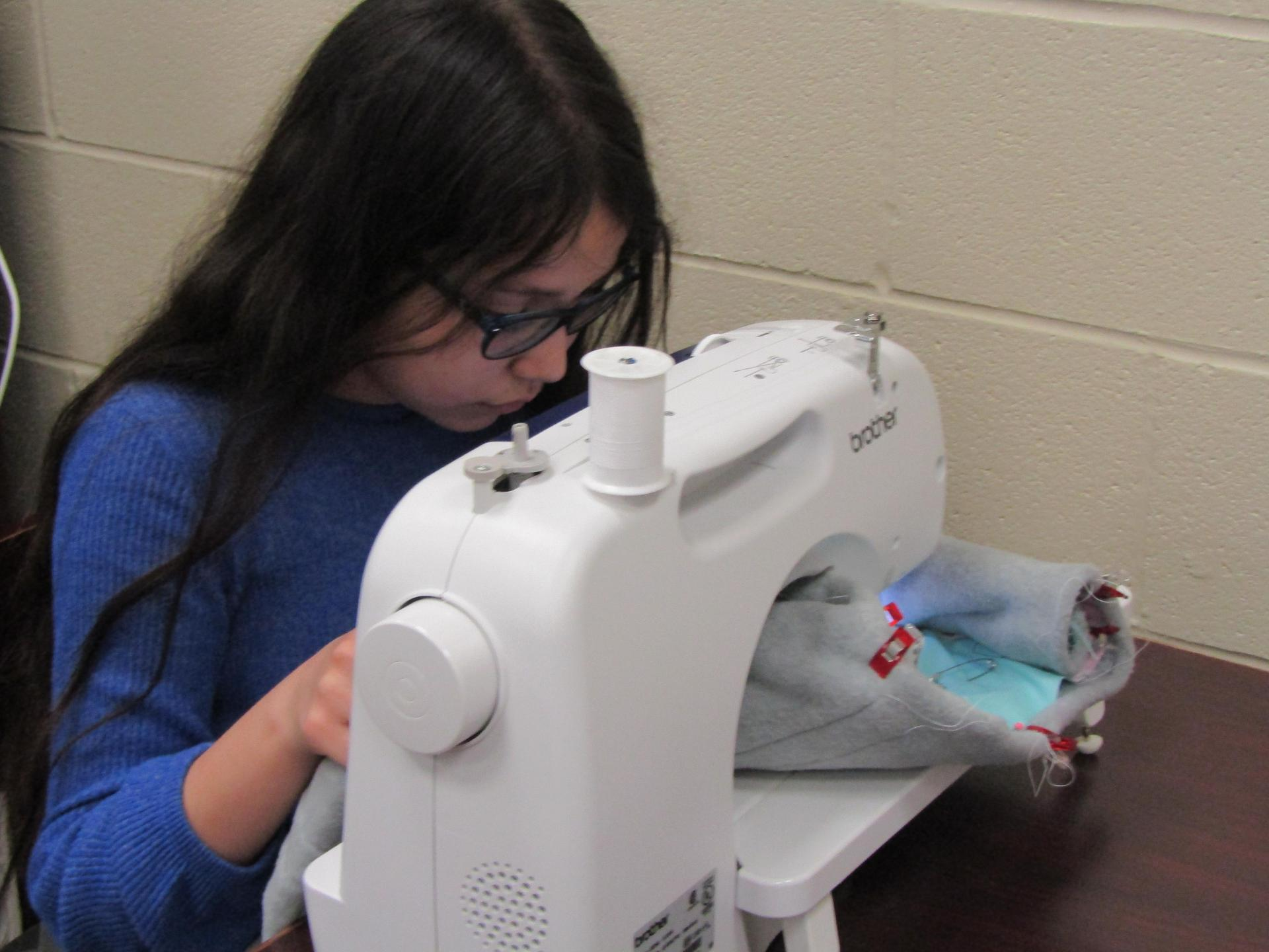 students sewing.