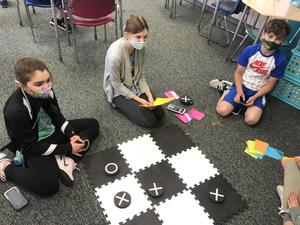students playing tic tac toe
