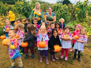 TK class at pumpkin patch with tie-dye shirts