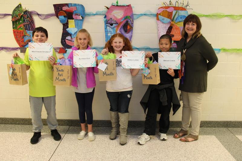 Pictured from left to right are B-L Elementary School students Matthew Storey, Alyssa Guy, Anna Long and Brian Chen.  Their art teacher, Karen Wheeler, is pictured on the far right. These students worked together to create an abstract portrait that won the elementary division of the central region's Youth Art Month (YAM) Art Show.