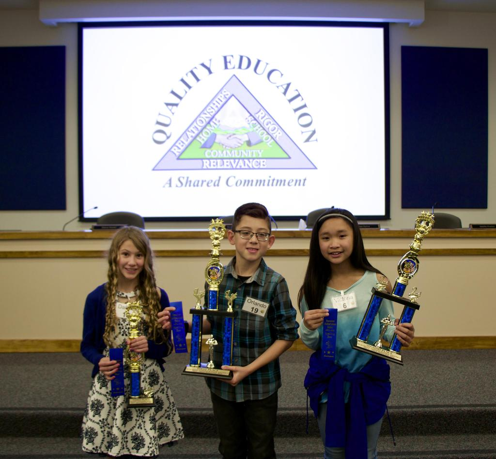 Students who placed first through third place with trophies