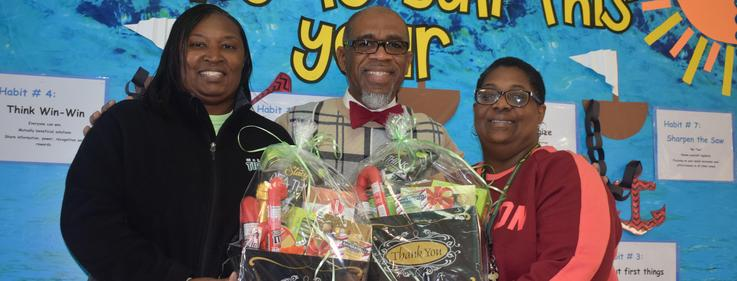 Higgins Staff receives random acts of kindness baskets from Superintendent.