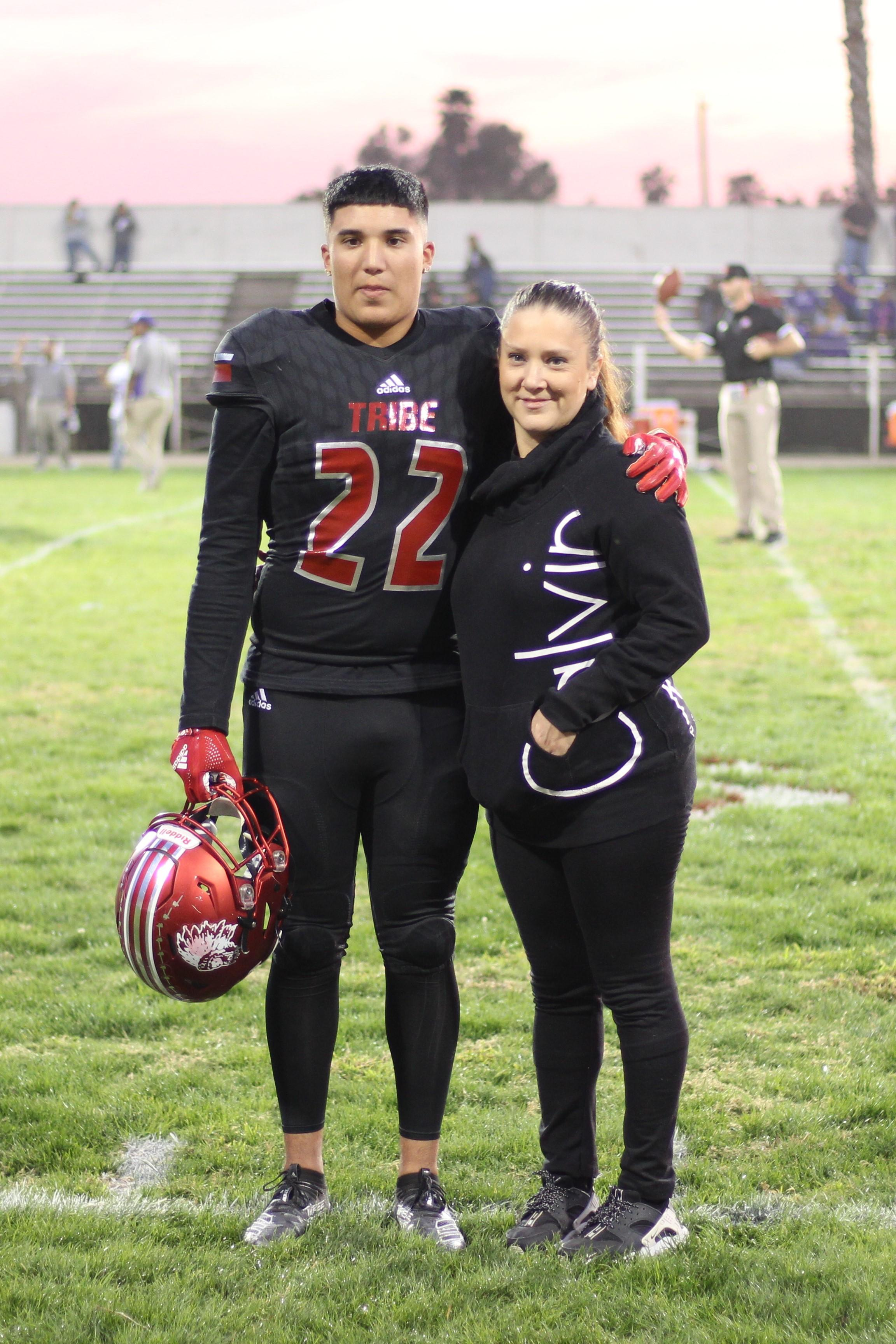 Senior football player Darian Lopez and his escort.