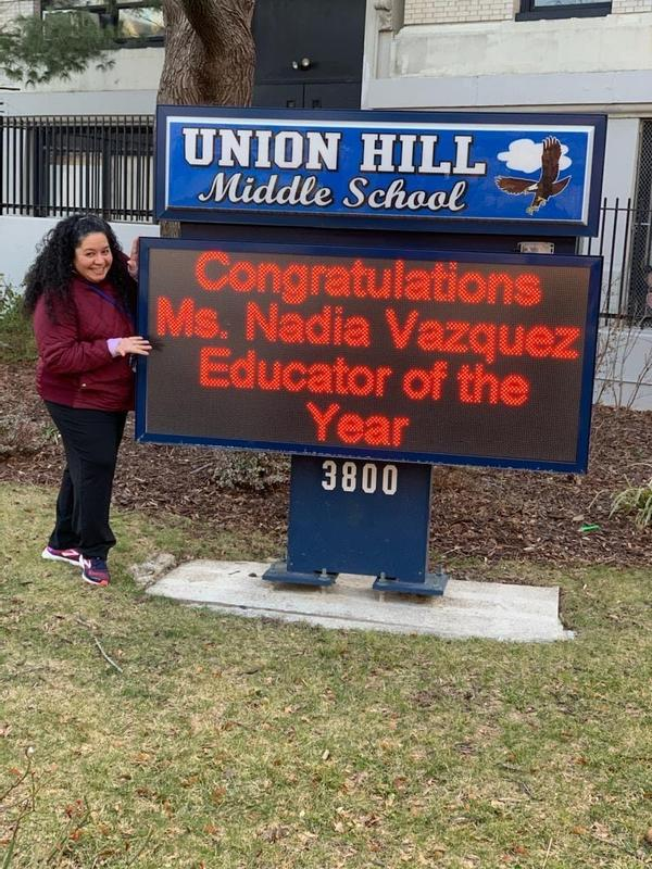 Nadia Vazquez in front of UHMS SIGN Teacher of the Year