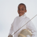 young fencing student in uniform