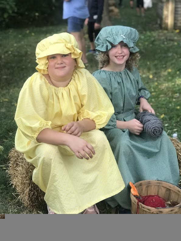 Students dressed in Pioneer clothing.