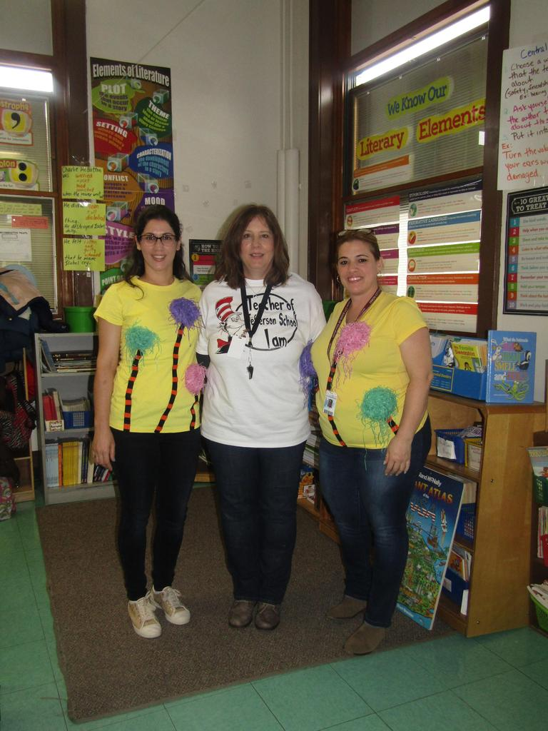 teacher and aides dressed in seuss gear