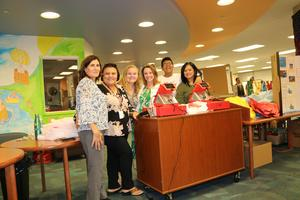 Ms. Hagedorn with her clerks at the Media center hosting a book fair