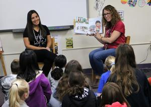Photo of Washington School guidance counselor and librarian reading a story of inclusion to 5th graders during Week of Respect.
