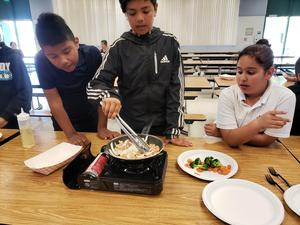 Students cooking at school.