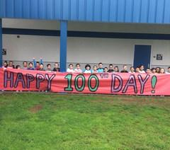 students holding 100 days of school sign