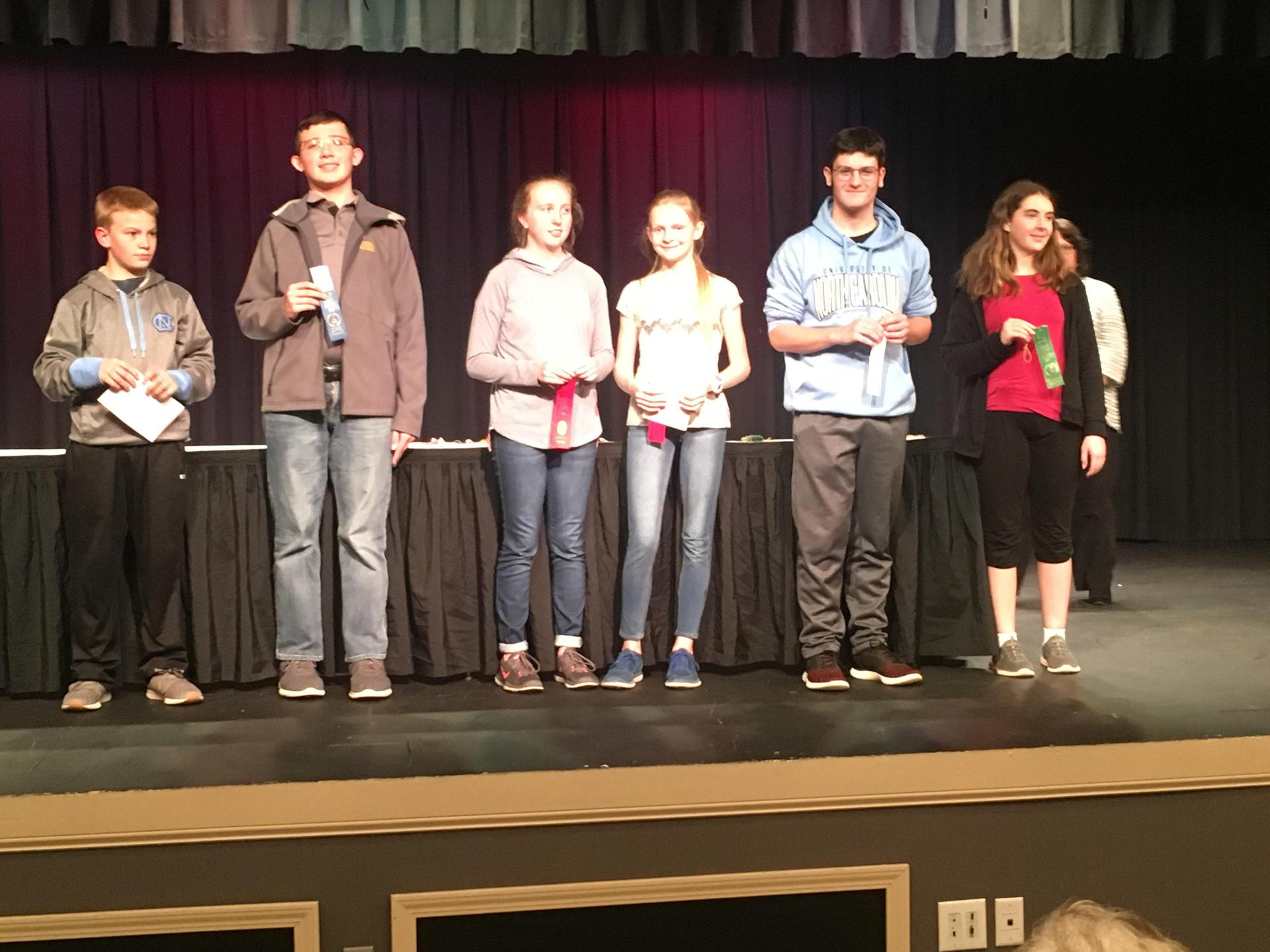 Students on stage at Science Fair Awards Presentation.