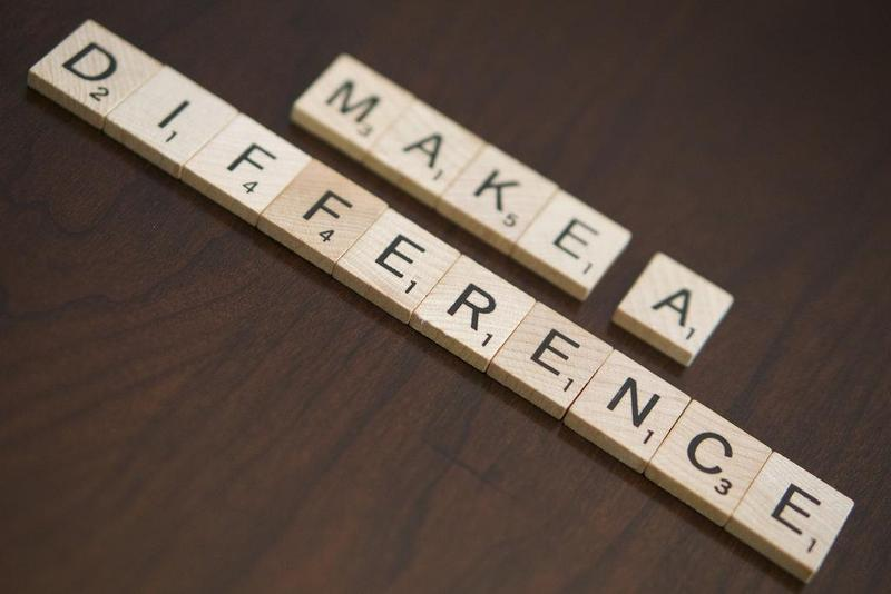 Scrabble tiles laid out to spell Make a Difference