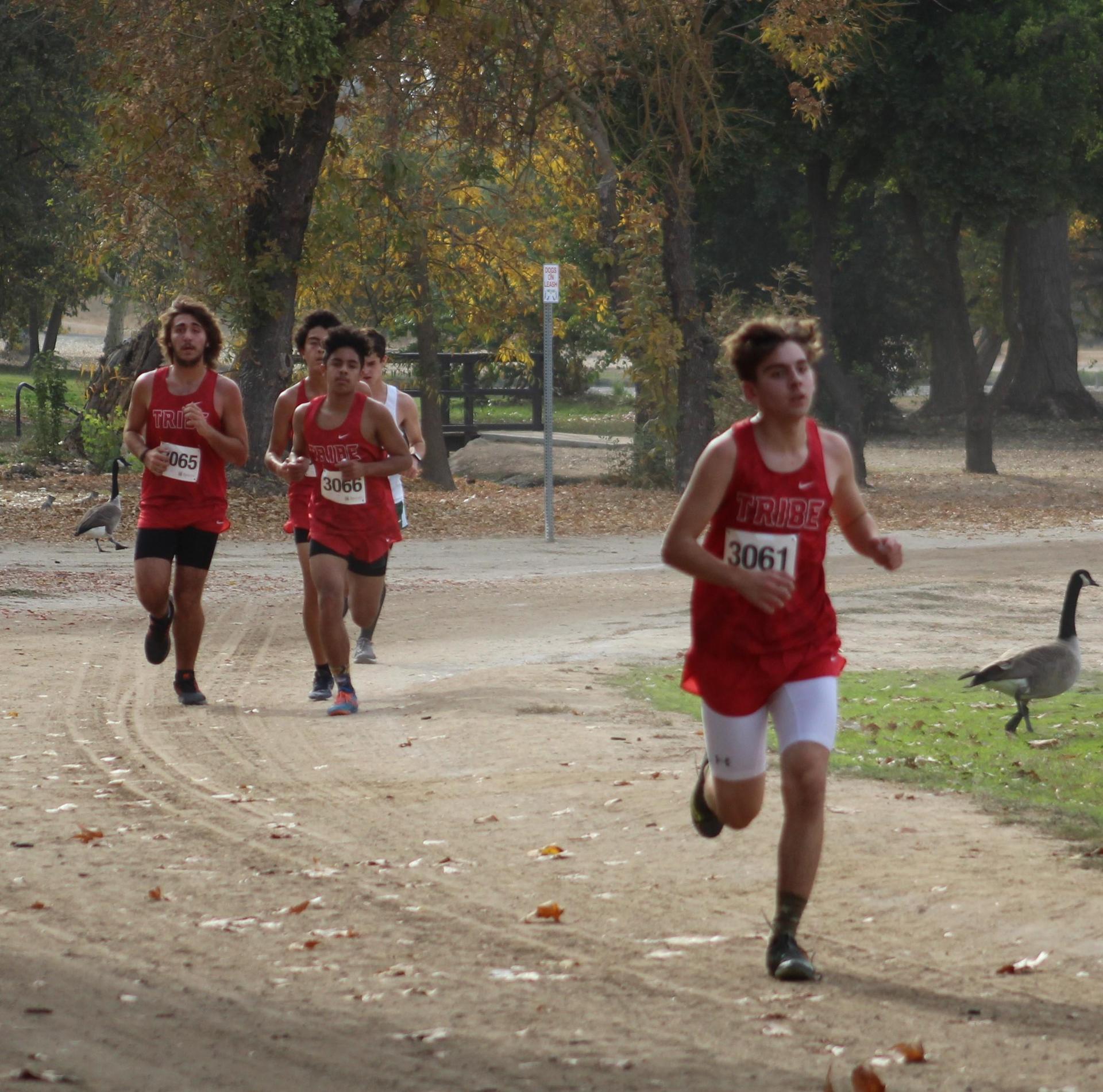 Antonio Brasil, Angel Gonzales, Carson Borba running