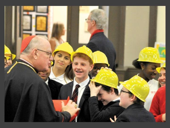 Cardinal visit with hard hats