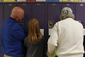 Students and their parents practice opening lockers at B-L Middle School's Sixth Grade Night on April 1st.