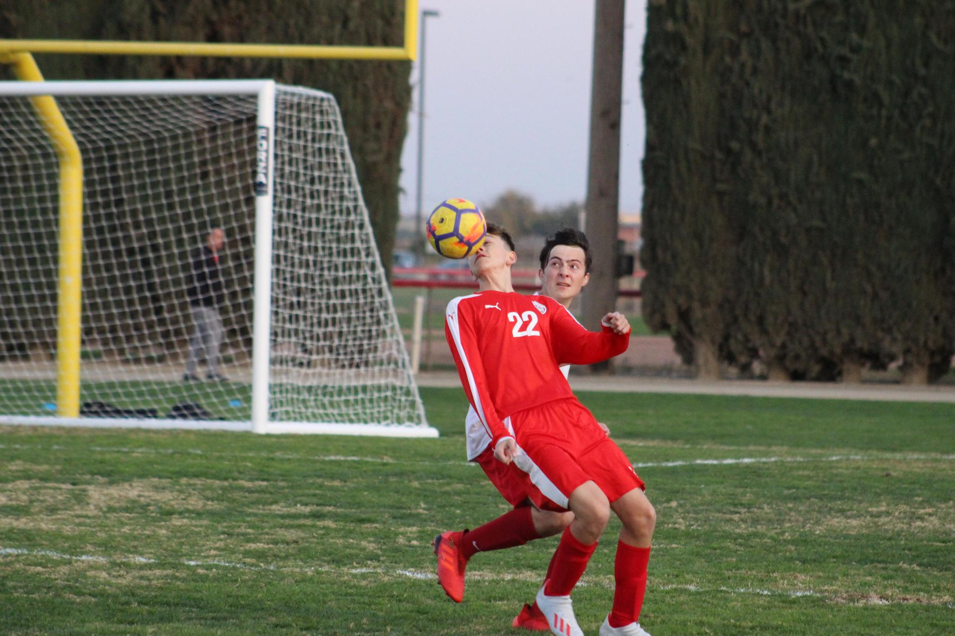 Andrew Garibay heading the ball