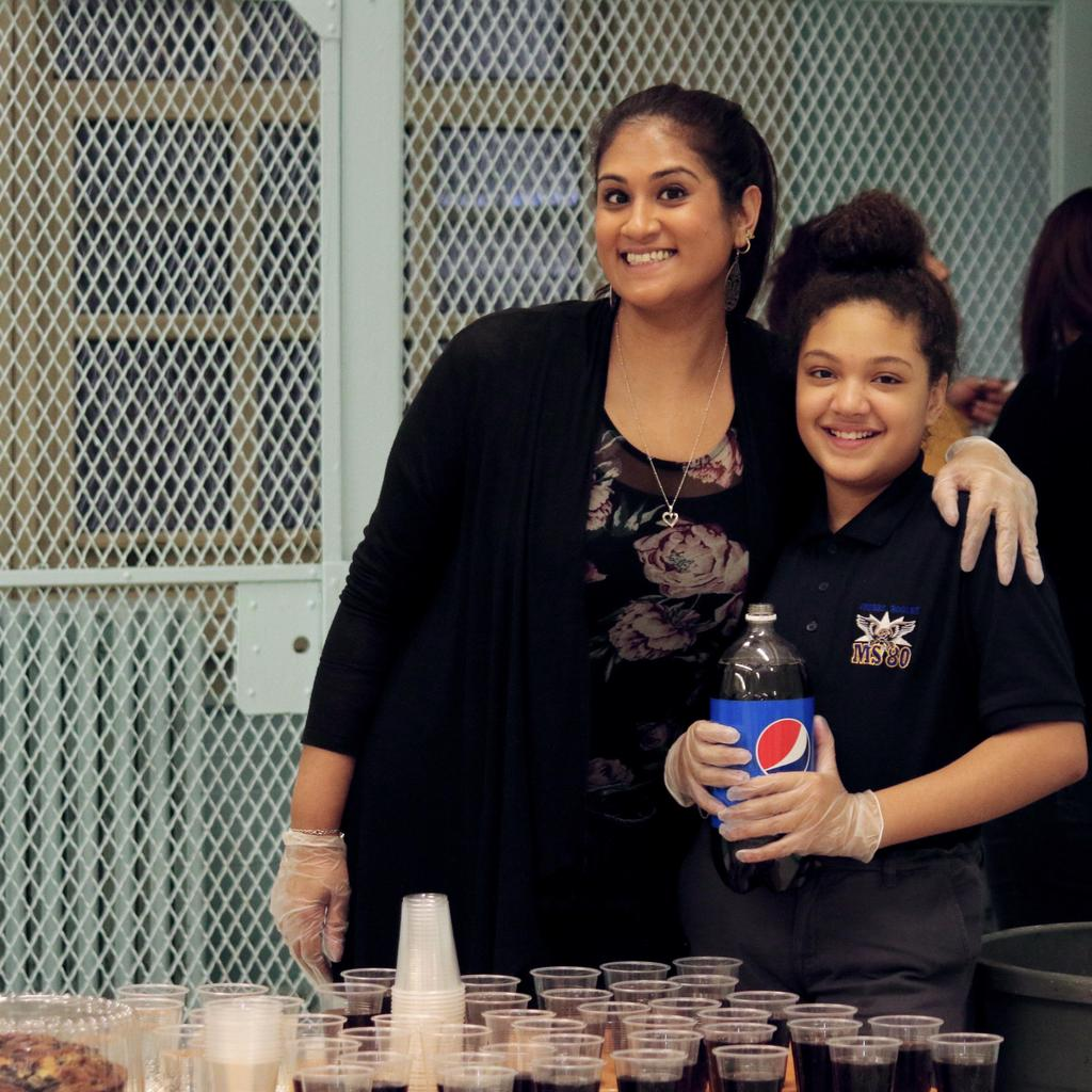 staff member and a student serving soda