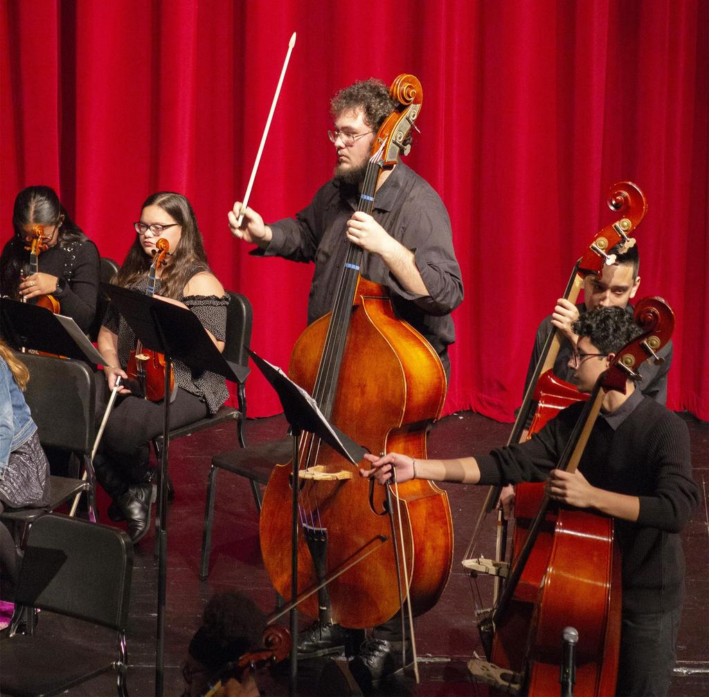 A section of the orchestra, prominently featuring a cello player