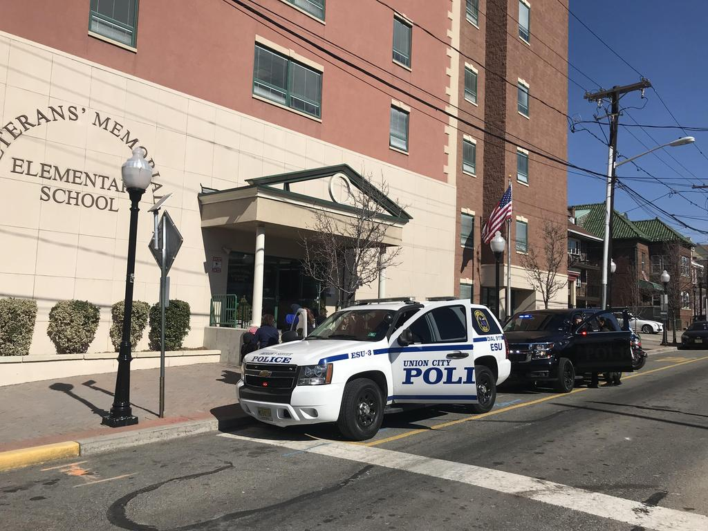 two union city pd cars parked in front of Vets