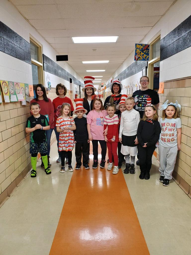 Second grade teachers and students dressed as Dr. Seuss characters