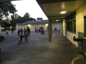 students and families walking past buildings on the Bridges Academy campus on Back to School Night