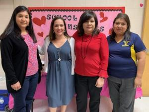 Staff poses with Ms. Sandoval