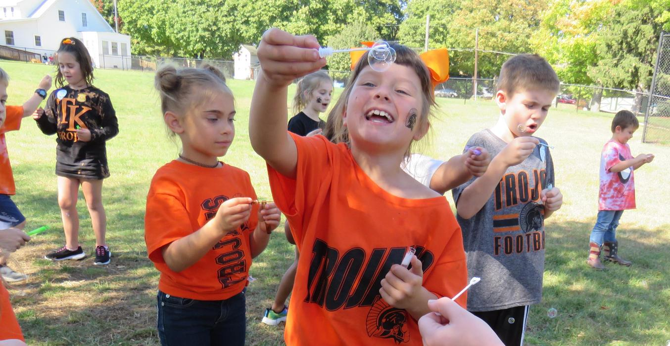 Students learn about the three states of matter while blowing bubbles.