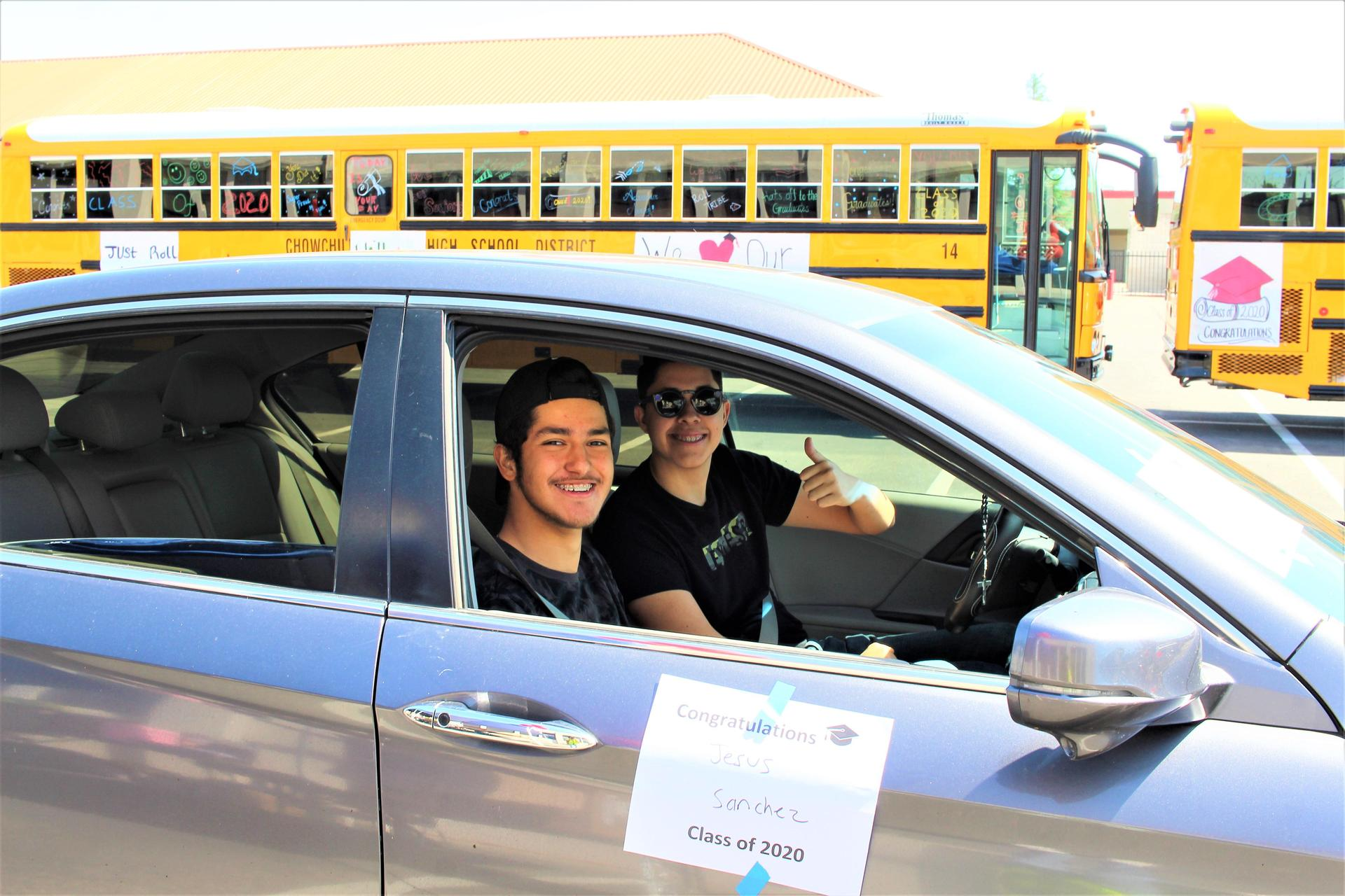 Jesus Sanchez riding with Emmanuel Garcia driving through