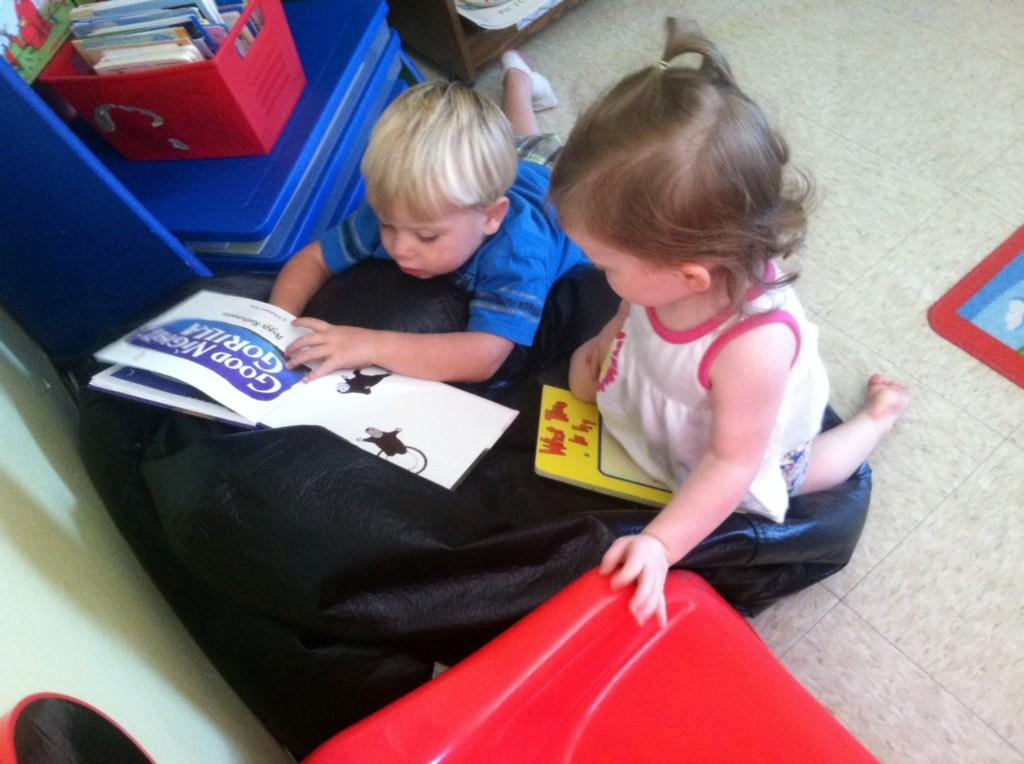 Sampson and Taylen looking at books.