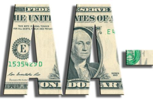 Dollar bills folded to create a credit rating AA-