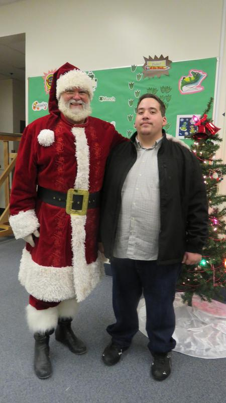 Santa poses with student organizer David Gomez.