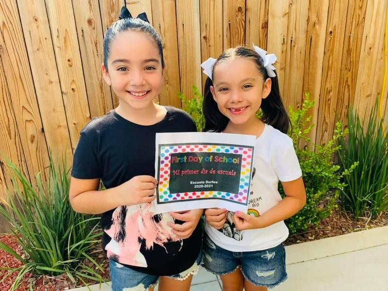 Durfee School students celebrate El Monte City School District's first day of the 2020-21 school year on Aug. 20 with smiles before joining their new classmates in a virtual classroom. El Monte City welcomed new and returning students at its 14 District campuses.