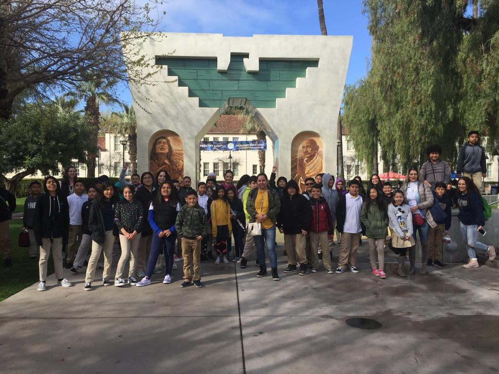 fifth grade students stand in front of monument at SJSU