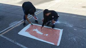 Students painting Frida