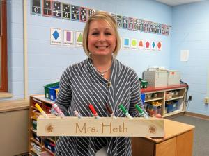 Ms. Heth uses her crayon holder to organize markers her students use.