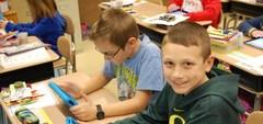 Elementary students use iPads to supplement their lessons.